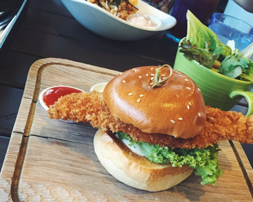 Crispy fish burgerrr (SGD14) with friesss (SGD9) - in the back